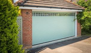 Green Garage door by Garage Doors Norfolk