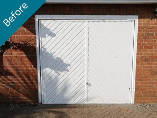 Old side hinged garage door in Spalding