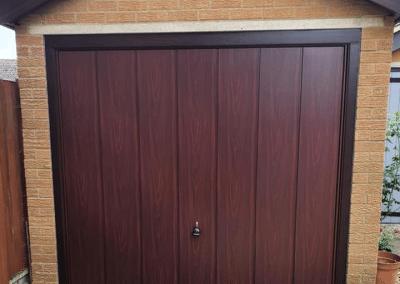 Garador Sherwood canopy door in Rosewood inc steel frame.