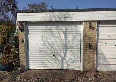 A Garador Horizon canopy garage door in white.