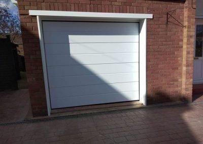 Novoferm insulated sectional door with a medium ribbed design.