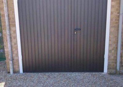 Garador Carlton side hinged garage doors in black.