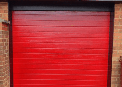 Hermann S ribbed insulated sectional door finished in Red.
