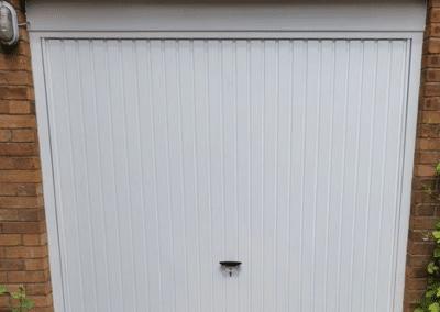 Novoferm Thornby retractable door in white inc a steel frame.