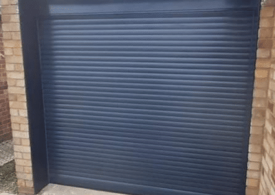 SWS compact roller door in Anthracite with matching guides and box.