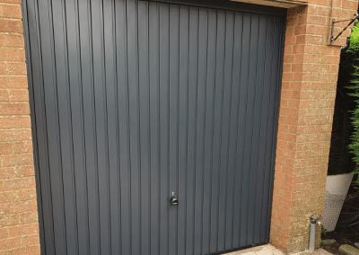 Garador Carlton retractable door in Anthracite inc a steel frame