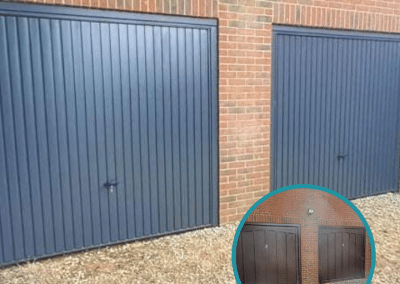 A pair of Novoferm Thornby retractable doors in Anthracite inc steel frames