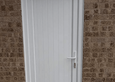 White upvc side door with a shiplap panel installed in Swaffham