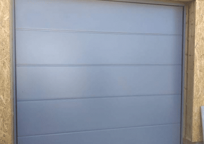 Carteck insulated sectional door finished in squirrel grey