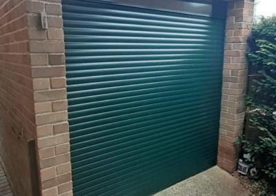 SWS compact roller door in fir green installed in Hunstanton