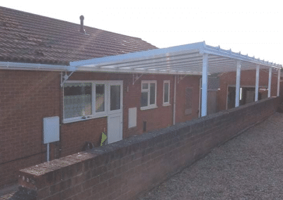 White upvc carport with a box gutter and reverse polycarbonate roof