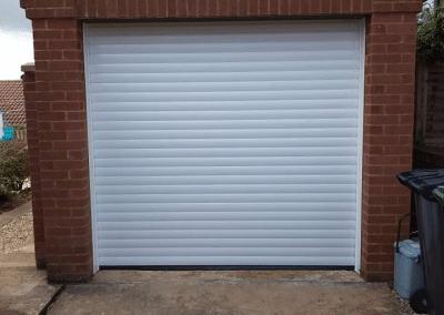 Trojon insulated roller door in white installed in Dersingham.