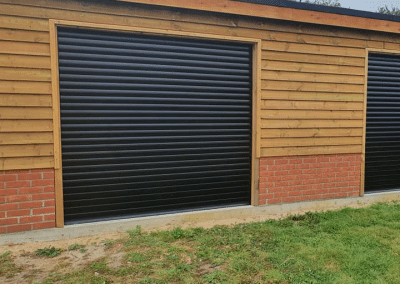 A pair of automated roller doors in black provide a stark contrast.