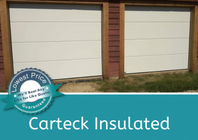A pair of Carteck insulated sectional doors in a solid design, with a cream smooth finish.