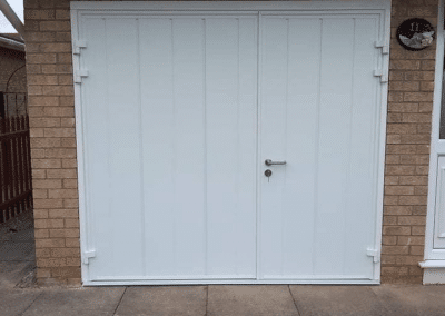 Carteck pair of insulated side hinged doors with 1_3 2_3 split.