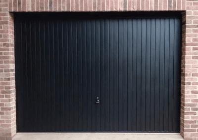 Black Garador Carlton retractable door installed in Terrington.
